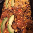 Black Bean and Quinoa Enchilada Bake - Black beans, quinoa, and sauteed vegetables are topped with enchilada sauce and Cheddar cheese in this vegetarian recipe for quinoa enchilada bake.