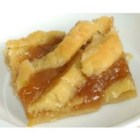 Old Fashioned Peach Cobbler - Flaky pastry enclosing peaches flavored with lemon and orange juice and spiced with nutmeg and cinnamon.