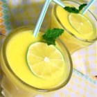 Mango Frappe - Pureed mango teams with orange and lime juices to make a refreshing slushy drink.