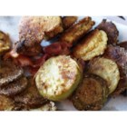 Kentucky Style Fried Green Tomatoes - These cornmeal-dipped green tomatoes get fried in bacon grease in the true Southern fashion.