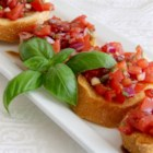 Italian-Style Bruschetta - Fresh diced tomatoes in a basil and garlic marinade top golden toast for a tasty Italian-inspired appetizer.