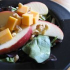 Jackie's Spinach and Apple Salad - This is a unique and delicious spinach salad with Granny Smith apples, walnuts, and Cheddar cheese. One of our family's favorites!