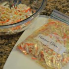 Freezer Slaw - Make a big batch of cabbage slaw, spoon into plastic bags, and freeze in big batches so all you have to do is thaw and add mayonnaise for the perfect 'freezer slaw'.