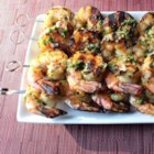 Chef John's Grilled Garlic and Herb Shrimp - A variety of fresh herbs and crushed garlic are used in both the marinade and the serving sauce in Chef John's grilled garlic and herb shrimp--a summer classic!
