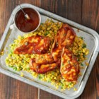 Backyard Barbecue Chicken - Chicken breasts are grilled in foil packets with corn kernels and bell pepper in a spicy barbecue sauce.