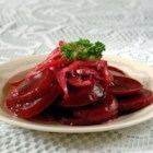 Marinated Beet Salad - Canned beets makes this a no-fuss salad to whip up. The sweet and sour dressing is heated and poured over the beets and diced red onion, and then it's popped into the refrigerator to chill.
