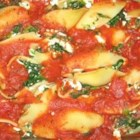 Pasta Shells Florentine - Everything about this entree is big. Big pasta shells, lots of great ingredients, and a huge success when you serve it to your guests. The shells are stuffed with oodles of cheese, spinach and tasty seasonings. And then they're smothered in spaghetti sauce.