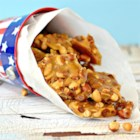Quick and Easy Peanut Brittle  - Stir peanuts with mixture of butter, sugar, and salt for a quick and easy homemade peanut brittle using this recipe.