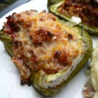 Yummy Stuffed Peppers - Combining several recipes led to the invention of this delicious stuffed pepper dish that fills each pepper with a mixture of rice, cheese, beef, and spices.