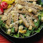Pork Caesar Salad from Smithfield(R) - Stir-fried strips of seasoned pork tenderloin make a delicious addition to Caesar salad with homemade dressing.