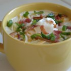 Baked Potato Soup I - This soup incorporates pre-baked cubes of potato with onion, crumbled bacon, cheddar cheese and sour cream in a milk soup base which has been thickened with a roux.