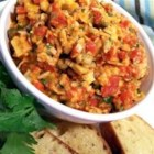 Roasted Red Pepper Tapenade - Roasted red peppers, artichoke hearts and garlic are the main flavors in this bright tapenade. This simple recipe can be used as a dip for vegetables and pita triangles or as a sandwich spread.