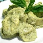 Basil Cream Sauce - After a mad search on the net for a recipe for this sauce I had to create my own. This can be reheated in the microwave without the usual cream sauce defects. I just love the light green color and how well it displays over tri color or regular pasta, salmon and grilled chicken. I have been putting this on everything.