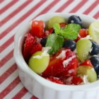 Fourth of July Salad - Berries, watermelon, and coconut are tossed together in this quick and easy salad perfect for Fourth of July picnics and barbeques.