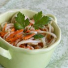 Cucumber Slaw - Cucumber slaw with carrots and onion is made with a light vinegar-based dressing that is quick and easy to prepare.