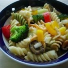 Rainbow Rotini Salad - Use colorful corkscrew pasta to make a festive cold salad packed full of fresh tomatoes, bell peppers, onions, cucumbers, broccoli and mushrooms. Toss with your favorite Italian-style salad dressing and chill to let the flavors blossom before serving.