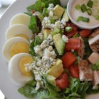 Cobb Salad - Everyone loves a Cobb salad and this is a great recipe. It makes plain old, shredded iceberg lettuce shine. Bacon, hard boiled eggs, chicken, tomatoes, blue cheese, avocado, green onion and dressing.