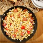 Quick and Simple Elbows with Spicy Curry & Gorgonzola - Elbow pasta seasoned with spicy curry is tossed with crumbled Gorgonzola and Parmigiano-Reggiano cheeses and cherry tomatoes.