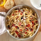 Nina's One Pan Greek-Style Penne - Penne pasta, kalamata olives and tomatoes topped with feta cheese crumbles is ready to serve in about 10 minutes.