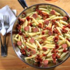 One Pan Franks n' Beans Pasta - Hot dog slices, baked beans, barbeque sauce, and penne pasta come together in a jiffy for this easy weeknight meal.