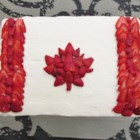 Canadian Flag Cake - Celebrate Canada Day with a flag cake! Vanilla sheet cake with a whipped cream cheese frosting, decorated with strawberries to make the Canada Flag.