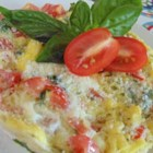 Margherita Mug Eggs - Tomatoes, basil, and ricotta cheese are cooked with eggs in a mug in this quick and easy, Margherita mug eggs recipe.