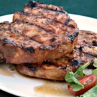 Early Autumn Smoked Pork Chops - Pork chops marinate in a sweet-savory sauce and are grilled with autumn leaves in the charcoals creating smoked pork chops perfect for the fall.