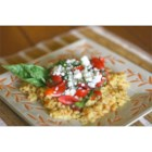 Orzo with Tomatoes, Basil, and Gorgonzola - Toasted orzo pasta is simmered with garlic, then tossed with fresh cherry tomatoes, basil, and gorgonzola cheese in this delicious Italian-inspired side dish.