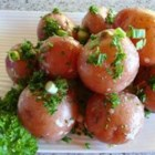 New Potatoes with Caper Sauce - Hot cooked new potatoes are gently tossed in a tangy, rich sauce of capers, parsley and grated Parmesan for a side dish that will steal the show.