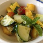Pineapple Cucumber Salad - Fresh pineapple, cucumber, and herbs with a chili-lime dressing combine in a light, refreshing salad.