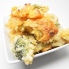 Meme Wales' Broccoli Rice Casserole - This oven-baked rice casserole features a mixture of onion, broccoli, and celery in a cheesy sauce made with prepared soup.