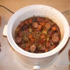 Slow Cooker Lentils and Sausage - Lentils, tomatoes, carrot and Polish sausage cooked in beef broth in a slow cooker.