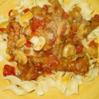 Swiss Steak Quick and Easy - Pounded cube steaks are lightly coated in flour and fried, then cooked with mushrooms, onions, brown gravy, and stewed tomatoes. Serve over a bed of egg noodles or rice with a hunk of thick, crusty bread.