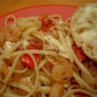 Shrimp and Feta Cheese Pasta - Shrimp is cooked in garlic and white wine, then tossed with pasta and feta in a fresh tomato sauce.