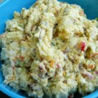 Slimmed-Down Potato Salad - Enjoy this no mayo potato salad with all the classic ingredients, from red potatoes to chopped hard-boiled eggs, celery, green onions, red bell peppers, and dill pickles. The low-calorie secret is the tasty silken tofu dressing. Chill from 4 to 24 hours to let flavors mingle.