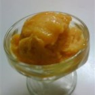 Mango Orange Sorbet - This recipe for the ice cream maker uses fresh mango, orange juice, sugar, and water.