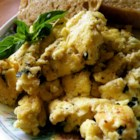 Creamy Cheesy Scrambled Eggs with Basil - Sour cream makes these eggs rich and creamy, and the basil adds a little kick of flavor.