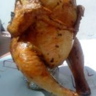 Beer Butt Rosemary Chicken - Beer can chicken is oven roasted with orange, onion, and fresh rosemary.