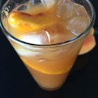 Peach Sangria - Pureed peaches are soaked in tart white wine and triple sec and topped with sparkling wine for a refreshing and fruity sangria.