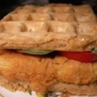 Chicken and Waffles - Fried chicken tenders, bacon, Cheddar cheese, and a sweet and spicy mayo are sandwiched between two waffles.