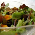 Mesclun and Mango Salad with Ginger Carrot Dressing - Mixed baby greens and diced mango are topped with a tangy dressing.