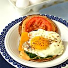 Cajun Fried Egg Sandwich - Egg, Cheddar cheese, tomato, and lettuce are seasoned with Cajun seasoning in this Cajun fried egg sandwich recipe.
