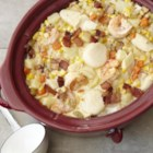 Slow-Cooker Fish Chowder - A creamy chowder full of shrimp, scallops, and chunks of halibut gets hearty flavor and a touch of sweetness from sweet corn, potatoes, and bacon.