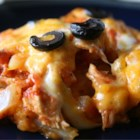 Southwestern Chicken Lasagna - Spaghetti sauce in the mix gives a nod to the Italian origins of this layered casserole, in which chicken in a spicy tomato sauce alternates with tortillas and cheese.