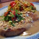 Thai Pork with Peanut Sauce - This is a very simple and quick dish that combines the standard pork chop with the wonderful flavor of coconut and peanuts. Even the kids loved it.