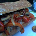 Scrumptious Steak Sammy - Thinly sliced pan-seared steak on a bun dressed with mushrooms, peppers, and cheese make up this favorite lazy weekend steak sandwich.