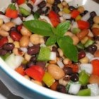 Three Bean Salad II - This is a simple yet tangy recipe for a traditional green bean, wax bean and kidney bean salad.