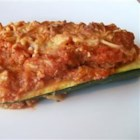 Italian Stuffed Zucchini - This is fun and so pretty as a side dish. Scoop out zucchini halves and stuff them with Parmesan cheese, pasta sauce and bread crumbs. Bake with a sprinkling of mozzarella cheese. Quite good.