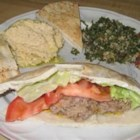 Middle Eastern Kibbeh - Made from a blend of cooked bulgur wheat, chopped mint, and onions stirred into ground lamb, then cooked as small patties, kibbeh is a favorite traditional dish in Lebanon, Syria, Palestine, and Iraq. Serve kibbeh with tahini, a sesame seed paste.