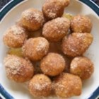 Georgia Dirt Bombs - Mini cinnamon popovers dipped in melted butter and rolled in cinnamon sugar are addicting and great any time of the day.